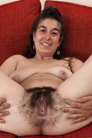 Ugly girl Lisandra in white sheer panties spreading her supremely hairy pussy
