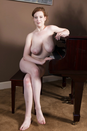 Busty redhead removes her short dress to let her huge saggy boobs hand low