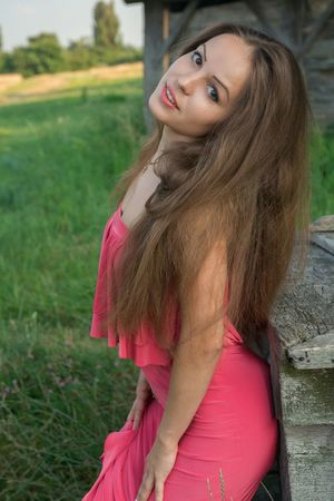 Young sweetie Arina G revealing freshly trimmed bush outdoors in the grass